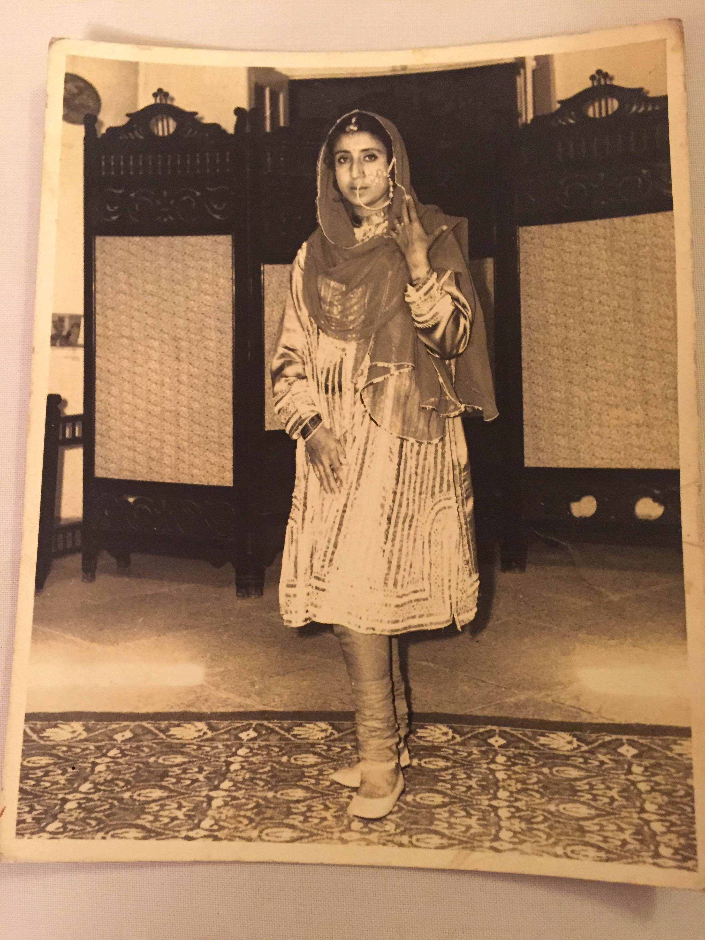 Photo of Keerti Kunzru modeling traditional Kashmiri attire.