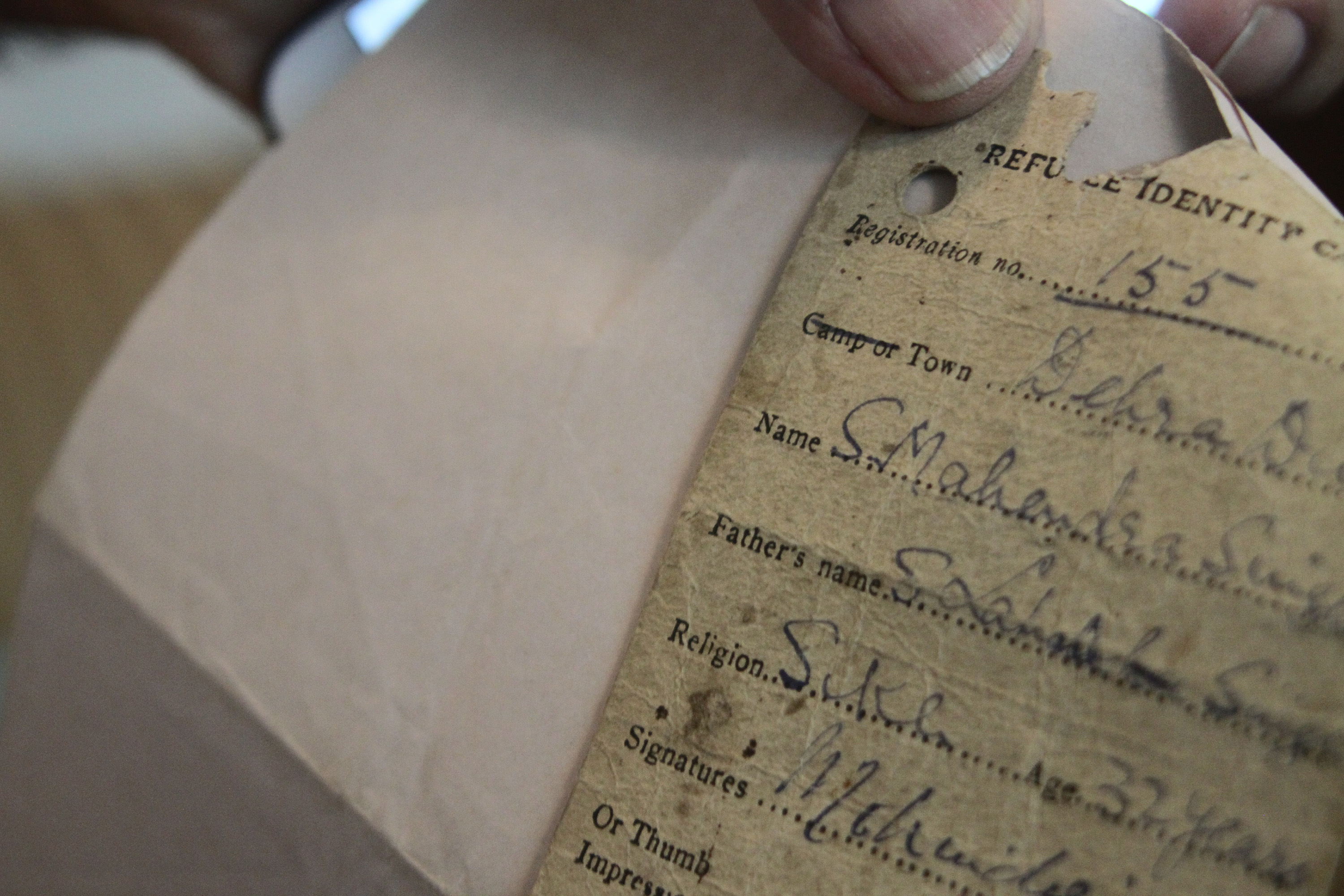 Refugee identification card that belonged to Rajinder Bir Singh Ahluwalia's father (back)