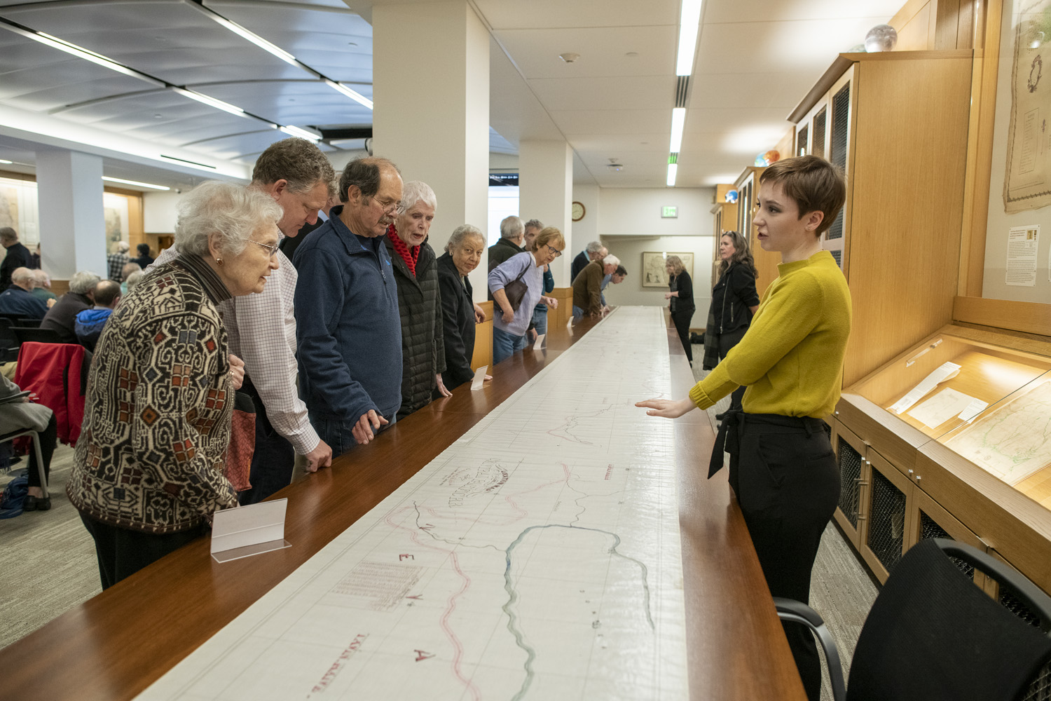 Anna Crist, right, of the Stanford Libraries digitization staff, answers questions from the many library patrons who came to see the 66-foot map unrolled. (Image credit: L.A. Cicero)