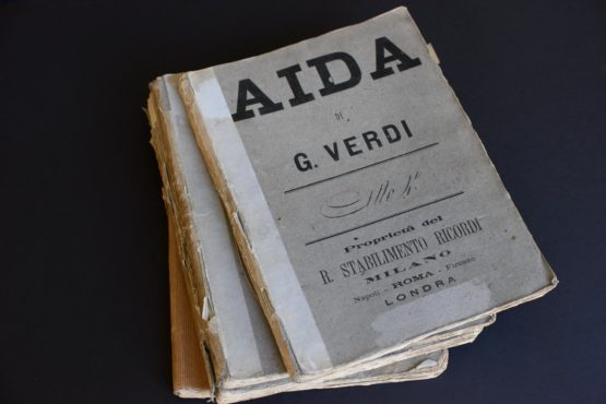 The four volumes that make up the handwritten manuscript used in the Paris premiere of Aida in 1876. (Image credit: L.A. Cicero)