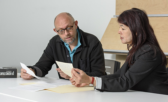 Pavle Levi, professor in Art and Art History, and D. Vanessa Kam, head librarian for Bowes Art & Architecture Library, examine a recently donated letter by Samuel Beckett to Radomir Konstantinović. (Photo by L.A. Cicero)