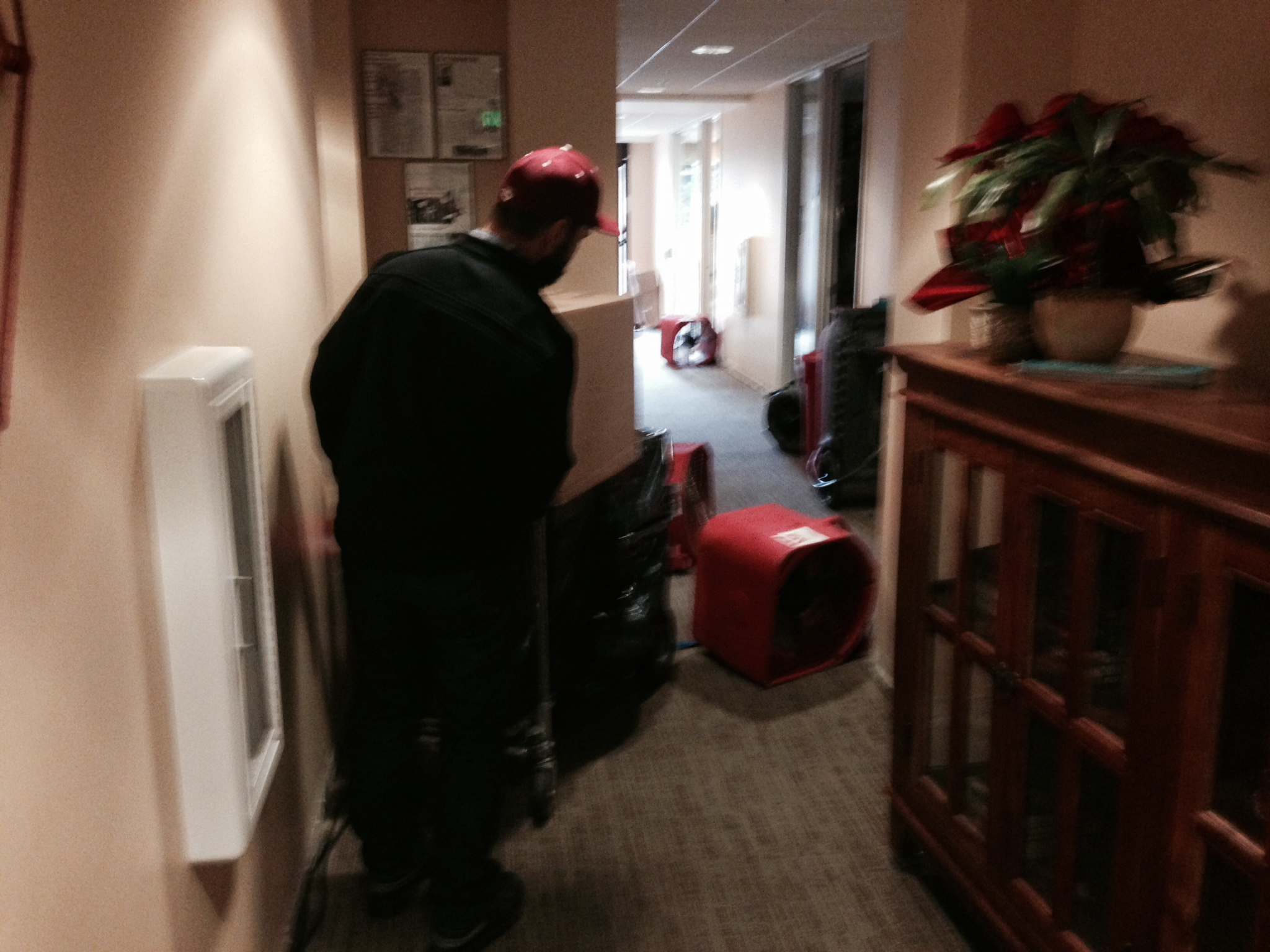 University Archives staff transfer the media from the flooded offices of the NACC in Old Union
