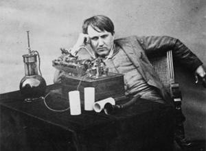 Edison listening to wax cylinder 1888