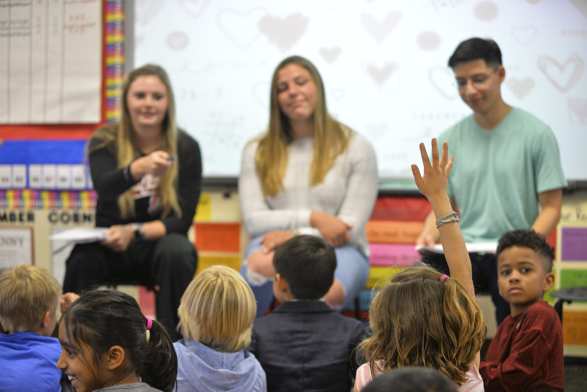 Kayler Detmer, left, Emily Delleman and Erick Siavichay hear the first-graders' opinions. Image credit: Rod Searcey