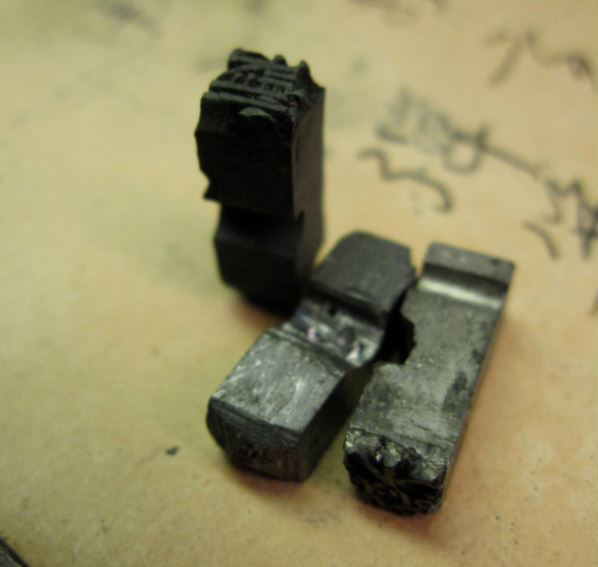 Chinese typewriters do not have keyboards. They have tray beds outfitted with nearly 2,500 character slugs. These slugs are loose, as in movable type.