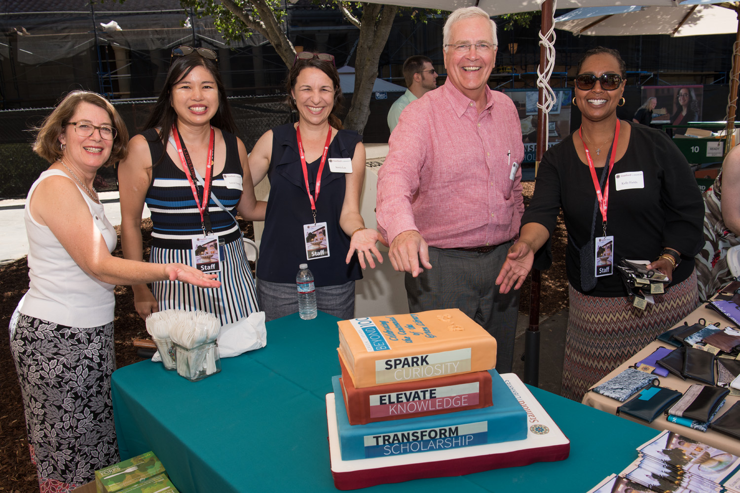 Library staff with University Librarian Michael Keller and the cake for the 100th Anniversary