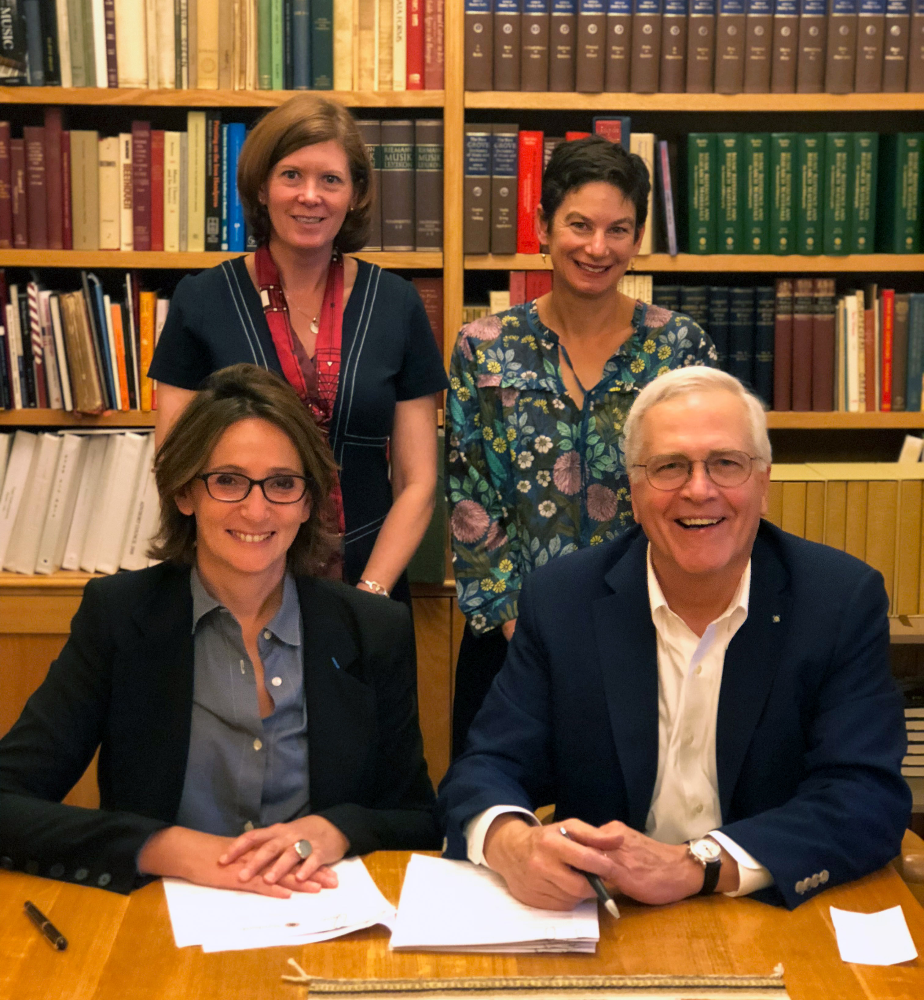 Seated (left to right) Laurence Engle, president of the BnF and Micheal Keller, university librarian and vice provost for teaching and learning. Standing (left to right) Mimi Calter, deputy university librarian and Sarah Sussman, Curator, French and Itali