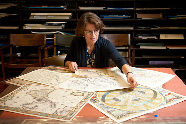 Librarian with rare maps.