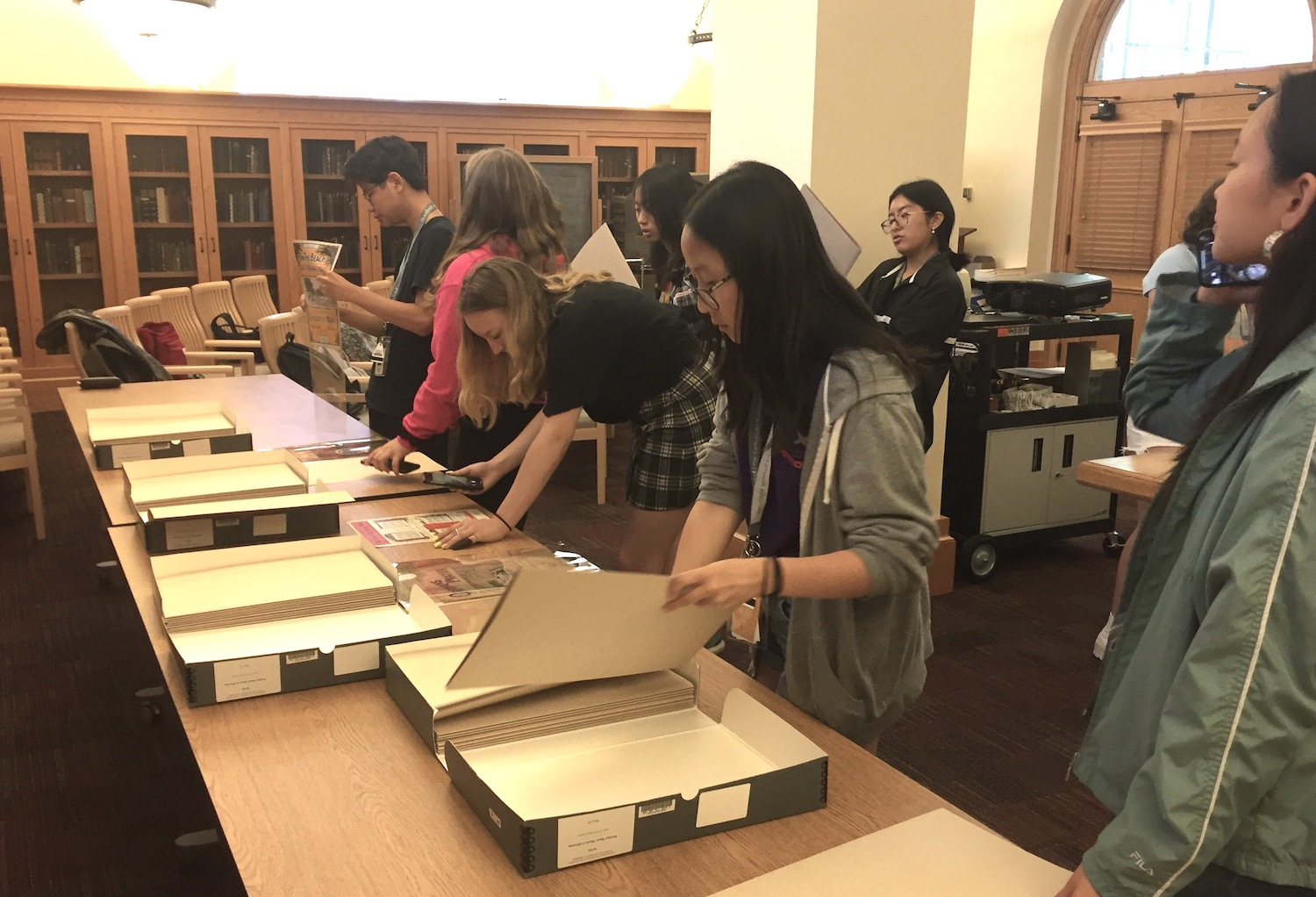 Students browse the Fielder Collection materials