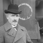 Arturo Toscanini poses on a ship's deck