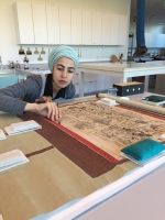 Aisha Wahab conserving a scroll