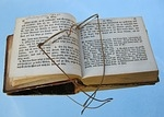 Eyeglasses over an open book