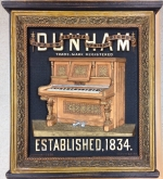 Large carved wooden poster for J.B. Dunham Piano Company