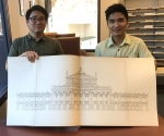 Music Library staffers Kevin Kishimoto and Vincent Kang display volume 1 of Modern Opera Houses and Theatres