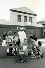 """Members of the Gay People's Union (GPU) pose in front of the old firehouse with a sign that reads """"gay freedom"""" during the GPU conference and gay pride week in June of 1974."""