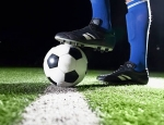 Stock image of a soccer ball and feet