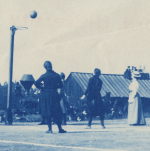 Women playing basketball on field, 1900