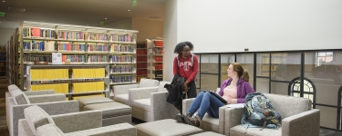 Sophomore Rhodalene Benjamin-Addy stops to chat with her former TA Natalie Geise a graduate student in Chemistry.