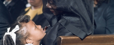 Coretta Scott King and Bernice King, King's youngest child, share a moment during King's funeral on April 9, 1968. Image credit: Bob Fitch Photography Archive, Department of Special Collections, Stanford University Libraries