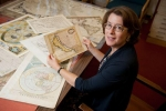Julie Sweetkind Singer, with maps depicting California as an Island.