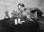 Thomas Edison listening to a wax cylinder, 1888