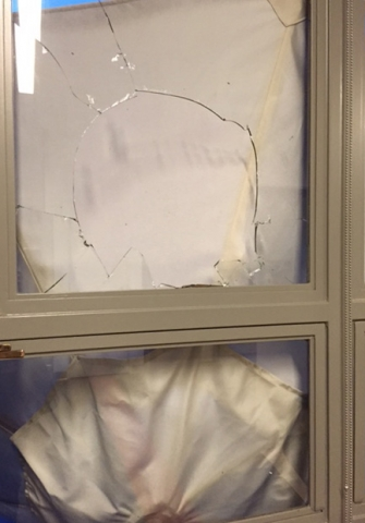Broken window at Lathrop Library