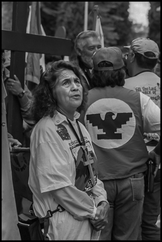 A tired Dolores Huerta in Sacramento, as the march reaches its end after a month. 1994. The David Bacon Archive, Department of Special Collections, Stanford Libraries.