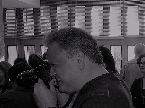black and white photo of Gil Mendez with camera