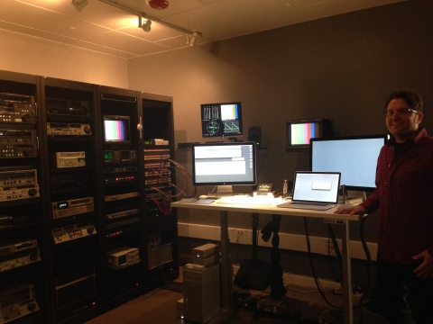 Michael Angeletti, Moving Image Digitization Specialist, in the video lab