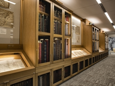 view of shelves at the Rumsey Center full of atlases