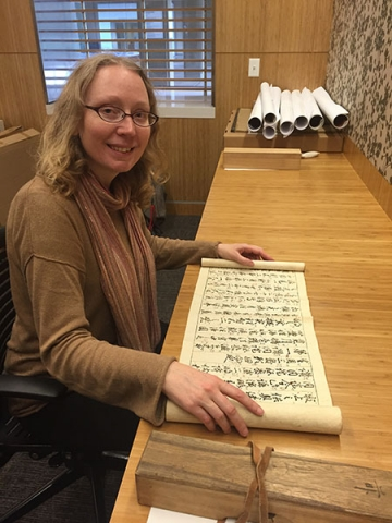 Dr. Michaela Mross examines a kōshiki scroll at the East Asia Library