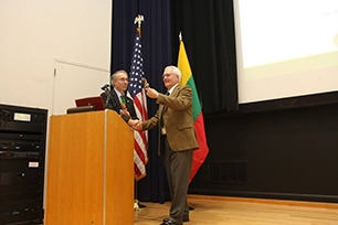 University Librarian Michael Keller receives bobblehead from Dennis Garrison, Lithuanian Honorary Consul