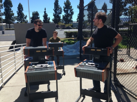 SMPL production team (L-R) Nathan Coy, Geoff Willard, and Michael Angeletti roll in the reel players