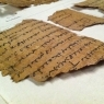 Papyrus fragment sitting on a table awaiting digitization