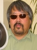 Ron Nakao with 9-track data tape.