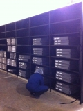 Staff loading newspapers on to new shelving at Newark.