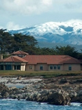 Hopkins Marine Station with snow on the mountains in the background