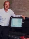 SLAC physicist Paul Kunz in 1998 with the first U.S. Web server, a NeXT computer.