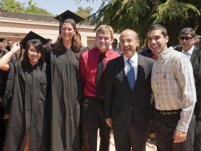 President Calderon with students at Commencement, 2011