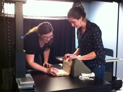 Astrid and Claire working together to image a fragile rare book.