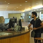 A student receiving assistance at the Information Center