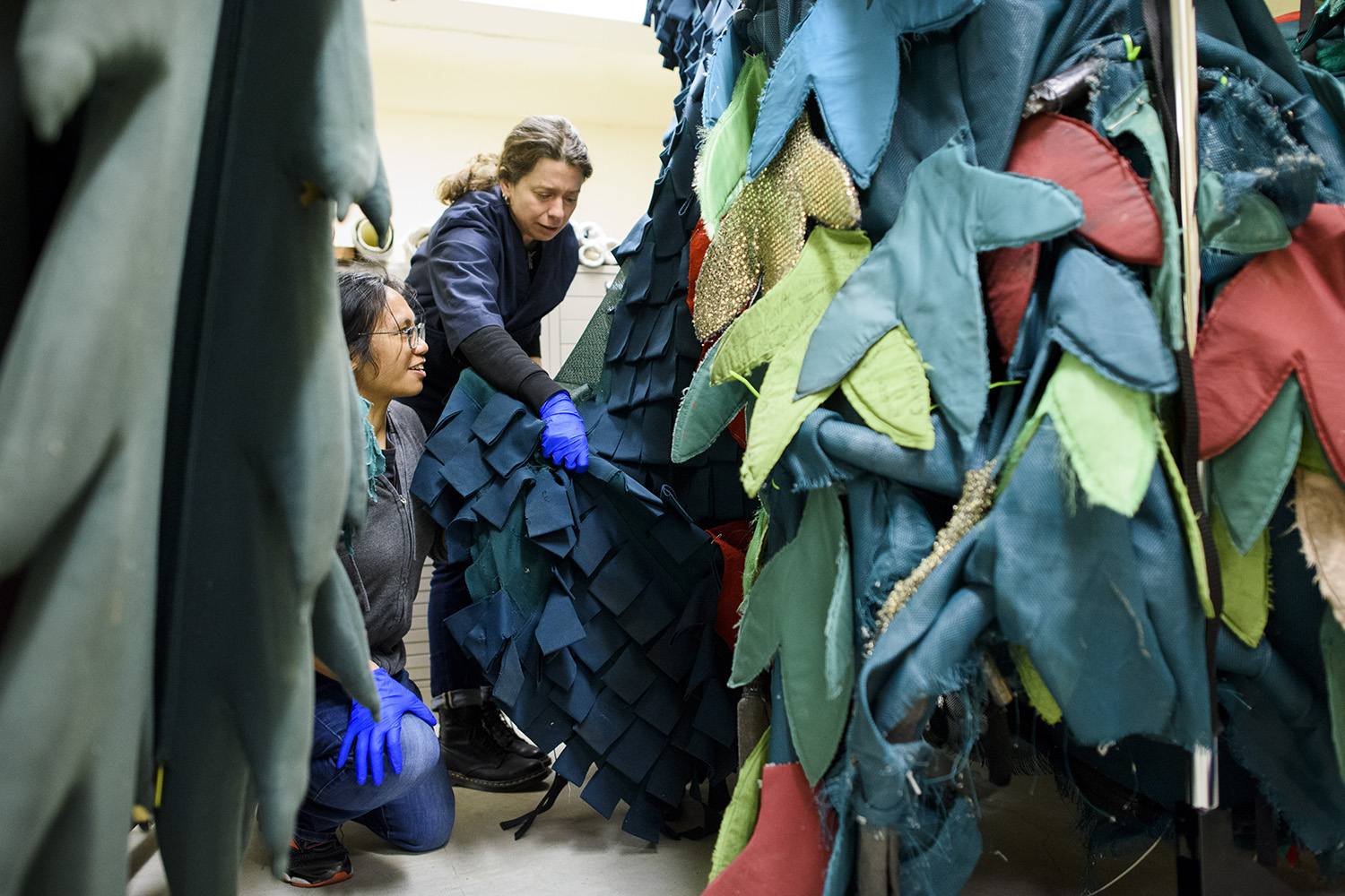Jill Sison and Sarah Newton, conservation technicians who work in the Stanford Libraries Conservation Lab, visit Green Library's collection to create custom garment bags for the Trees. (Image credit: L.A. Cicero